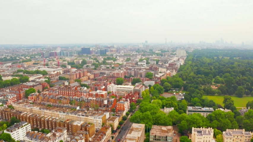 Aerial panoramic view of the Hyde Park in London, UK. City center on the horizon. | Shutterstock HD Video #1033218902