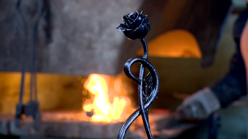 The art of the master in the smith of a forging metal with the help of the hammer of fire and the craft of tradition | Shutterstock HD Video #1033244852