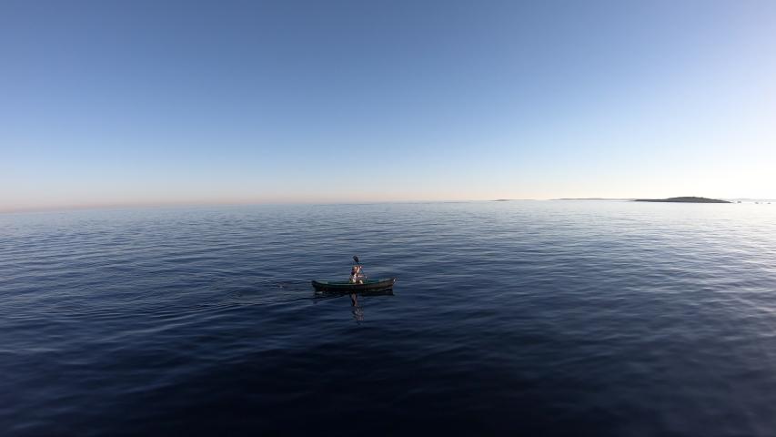 AERIAL FOOTAGE: Person sea kayaking #1033257632