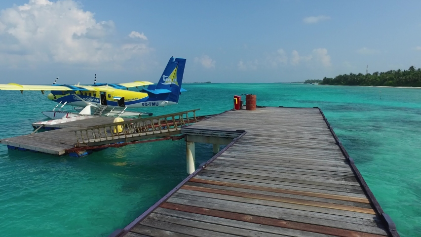 Maldives, MALE, 2018: Trans Maldivian Airlines arrives, hydroplan of TMA company. Seaplane, that takes tourists from capitol city Male to chosen Island Resort #1033295912