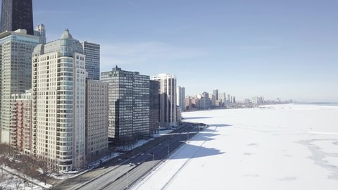Aerial view of Chicago Downtown In Winter next to frozen lake Michigan - Shot with Colorgrading