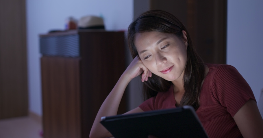 Woman use of tablet computer at night | Shutterstock HD Video #1033471022