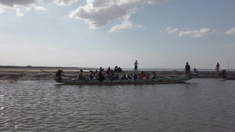 Irukkam Island, Andhra Pradesh / India - July 20 2019: People getting on a boat in Irukkam Island during daytime