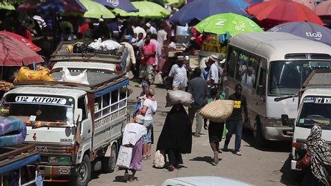 ZANZIBAR, TANZANIA - JUNE 30 2017: vans carrying a market place and freight.