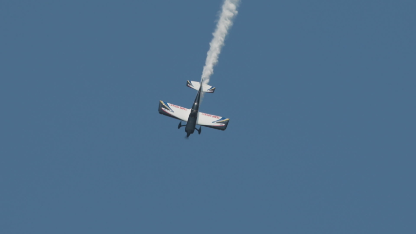 Hay river, northwest territories / Canada - 07 09 2019: Stunt plane dives and rolls   Shutterstock HD Video #1033800992