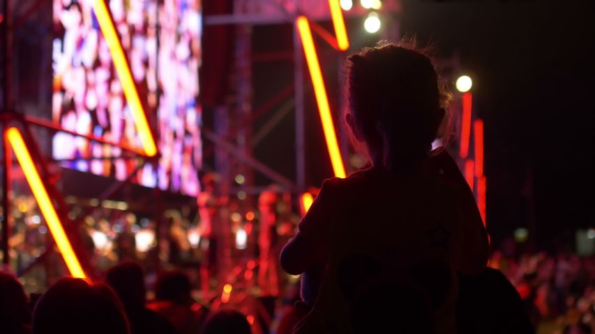 Father Holding Child Daughter Girl On Shoulders Enjoying Street concert by night | Shutterstock HD Video #1033962572