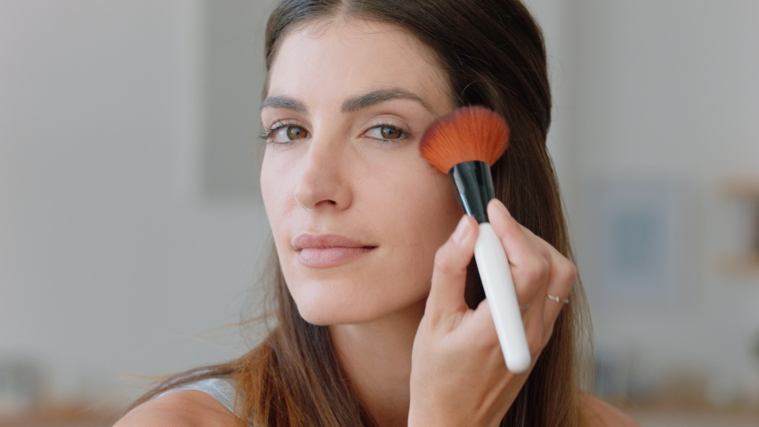 Portrait beautiful young woman applying makeup getting ready at home looking in mirror enjoying natural complexion feminine beauty 4k footage | Shutterstock HD Video #1034109722