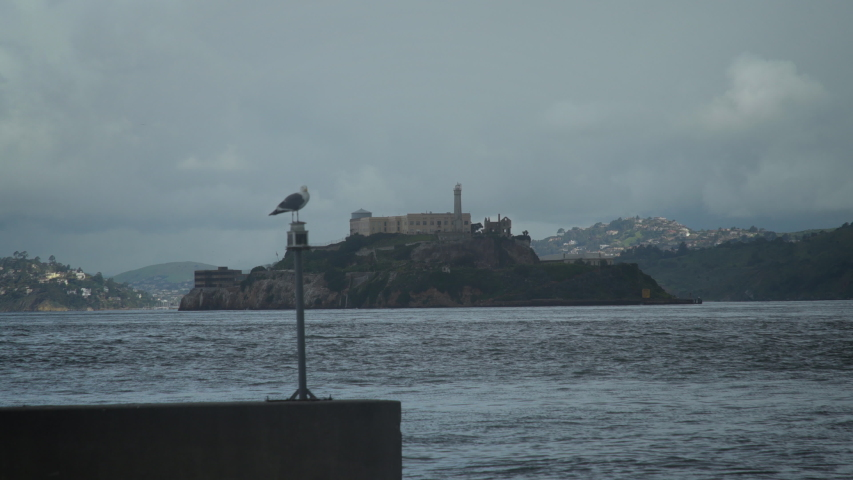 This cinematic scene of Alcatraz Island from Fisherman's Wharf on Pier 39 in San Francisco is the perfect setting shot for your travel show, historical doc, and more!  Shot in 4K UHD resolution. | Shutterstock HD Video #1034395472