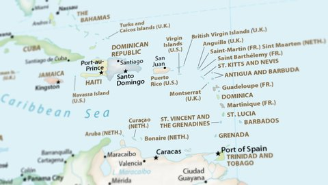 Haiti, Dominican Republic and Puerto Rico on a political map of the world. Video defocuses showing and hiding the map (4K UHD).