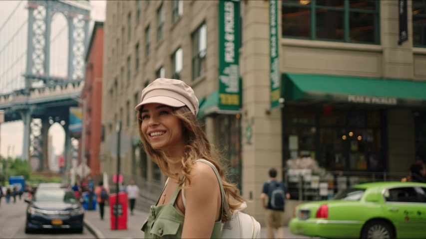 French tourist walks around Brooklyn and enjoying it, famous view on Manhattan Bridge, first time in New York, traveler's life. | Shutterstock HD Video #1034485322