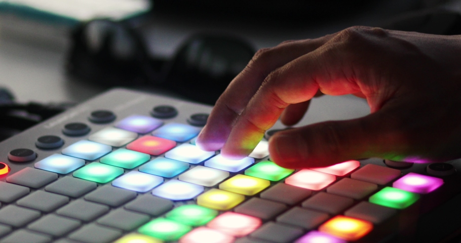 A DJ adjusts the volume and other levels of a song on a mixer.  | Shutterstock HD Video #1034559782