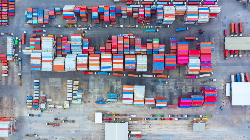 4k, Aerial view semi truck with cargo trailer loading and unloading with other trucks on industrial port parking. | Shutterstock HD Video #1034607122