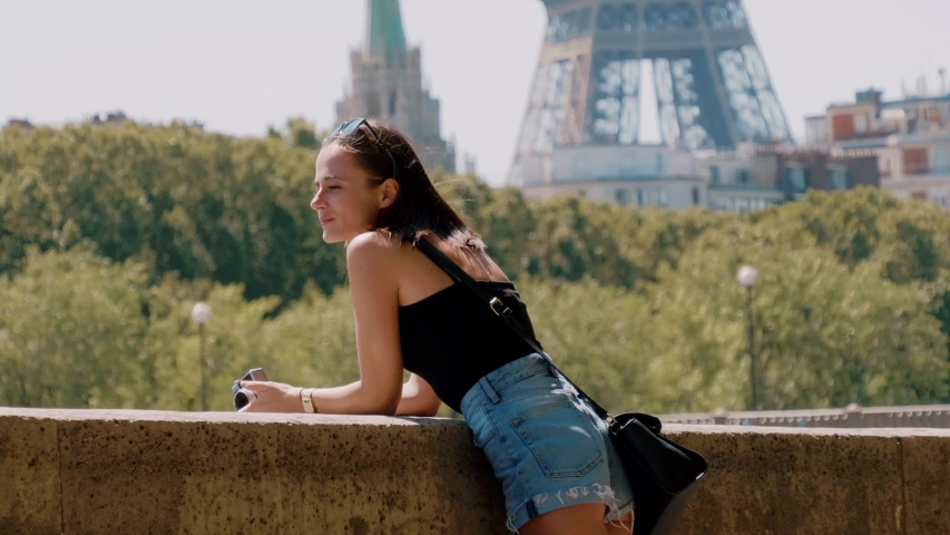 Young woman at River Seine in Paris | Shutterstock HD Video #1034647922