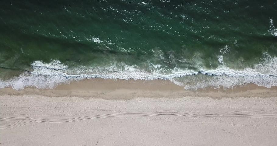 Top Down Aerial Shot Of Foamy Green Waves Of half moon bay beach empty hold | Shutterstock HD Video #1035005972