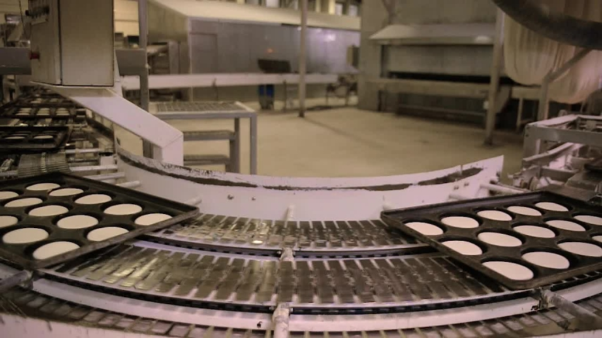 Time-lapse of trays of dough transferred automatically inside bread factory | Shutterstock HD Video #1035118412