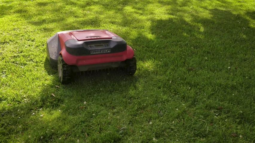 Robomow robotic automatic lawn mower | Shutterstock HD Video #1035156572