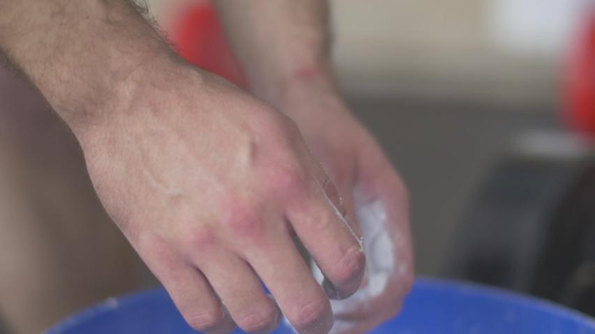 Man chalking hands before workout. slow motion | Shutterstock HD Video #1035240692