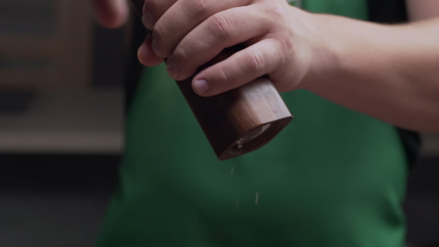 Macro shot: chef uses salt mill to add some salt for his meal, salt falls in slow motion, milling the salt, using kitchen stuff, Full HD prores 422 HQ | Shutterstock HD Video #1035272432