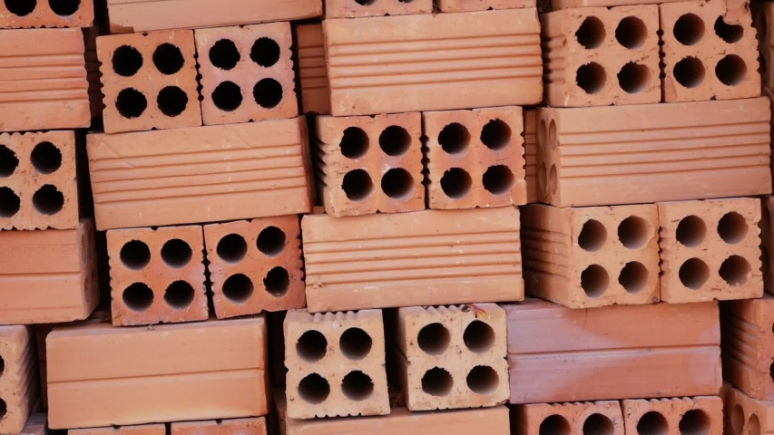 Red brick stack at outside on construction site. | Shutterstock HD Video #1035346082