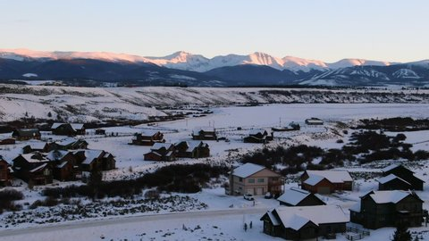 Aerial Dolly Zoom: Snow Covered Houses in Tabernash Neighborhood with View of Rocky Mountains
