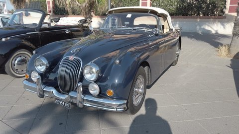 Rome,italy - july 20, 2019:on occasion of rome capital city rally event, an  exhibition of vintage cars has been set up with the beautiful black car  jaguar xk150 manufactured by british jaguar
