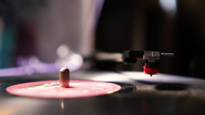 hands turning an antiquarian record player on . vinyl record spinning. Wide shot close up of needle playing record album on a vintage turntable. Old school record player . | Shutterstock HD Video #1035517322