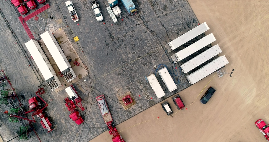 Drone rises in this downshot of a hydraulic fracturing (fracking) site. The entire operation is revealed. | Shutterstock HD Video #1035578492