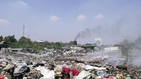 Landfill with a lot of trash and smoke near Jakarta area. There're a lot of pollution in this site. People burn everything and let it be inhaled by everyone.