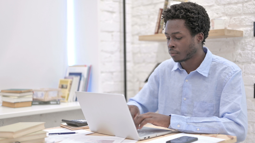 Young African Man working on laptop | Shutterstock HD Video #1035670262