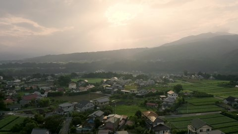4k aerial drone footage - The beautiful mountainous countryside of Japan.  The many rice fields, mountains, and villages of Gunma Prefecture.