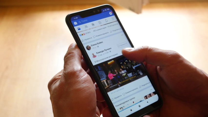 WROCLAW, POLAND - AUGUST 26, 2019: A Man watching a funny Video with Cat on Facebook | Shutterstock HD Video #1035901712