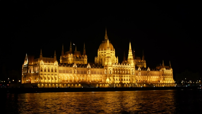 Budapest Hungarian Parliament and night time on the Danube river, Budapest, Hungary, Holidays in Budapest | Shutterstock HD Video #1035909842