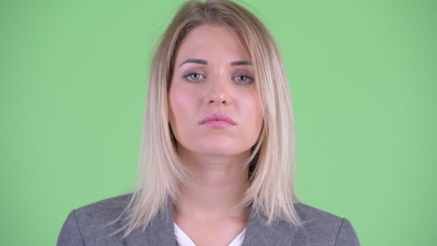 Face of serious young blonde businesswoman nodding head no | Shutterstock HD Video #1035919892