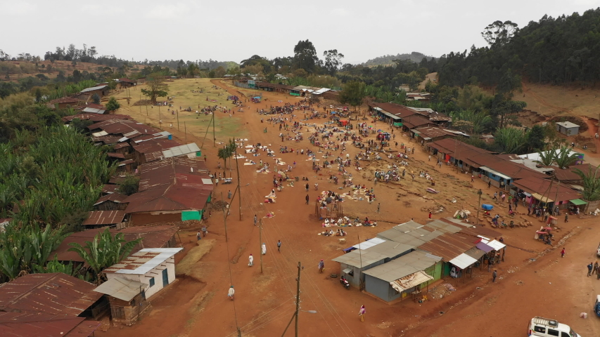 Tilting drone flight of busy local farmers market in tribal village of Dorze, traditional rural community in Ethiopia Africa  | Shutterstock HD Video #1036061072