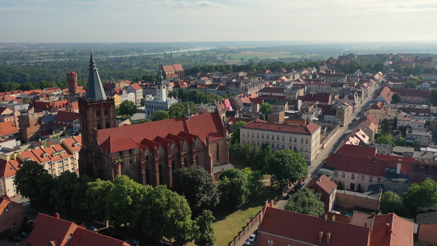 Aerial view of a historic church in Poland   Shutterstock HD Video #1036088462