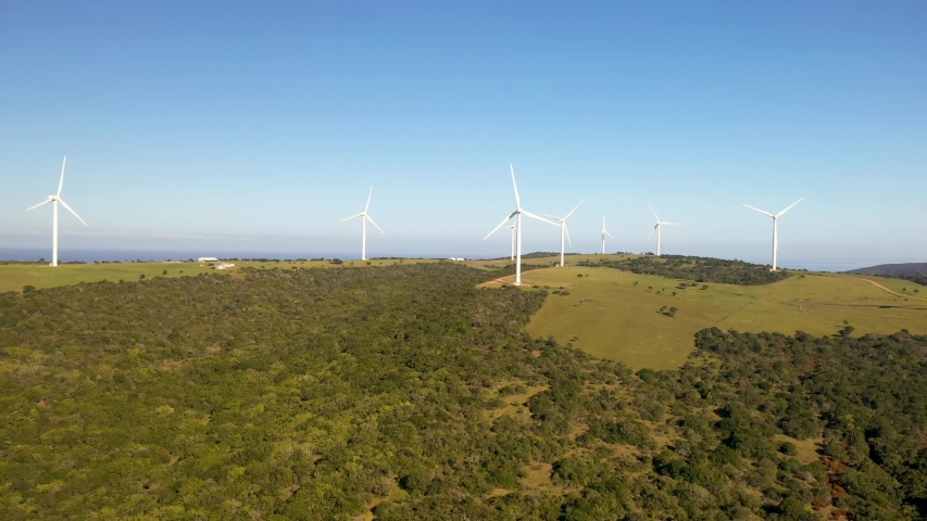Aerial view of windmills next the ocean in South Africa   Shutterstock HD Video #1036153322