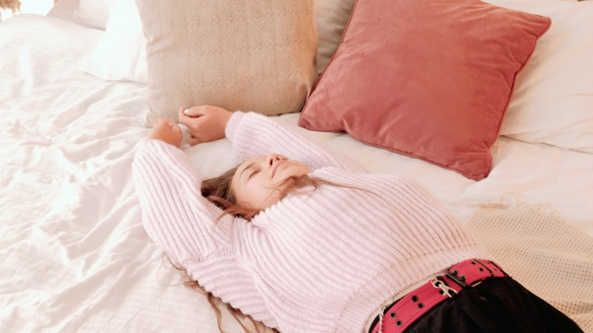 Hard working day end. Leisure relaxation recreation. Exhausted girl dropping on bed. | Shutterstock HD Video #1036335842