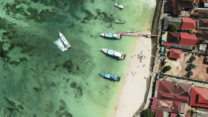 Aerial Drone Shot of Nusa Lembongan Top Down View of Main Beach with Boats and Reef, Indonesia | Shutterstock HD Video #1036536422