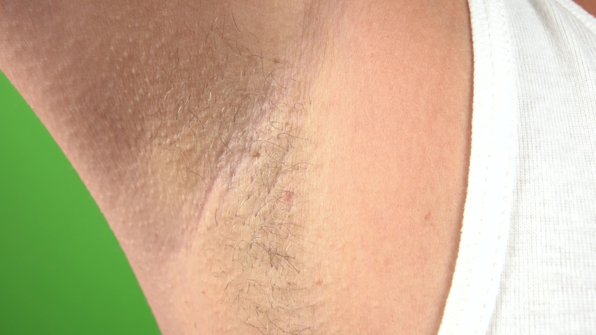 Closeup view of female armpit with hair growing. Modern trand of natural beauty concept. Real time 4k video footage. | Shutterstock HD Video #1036570862