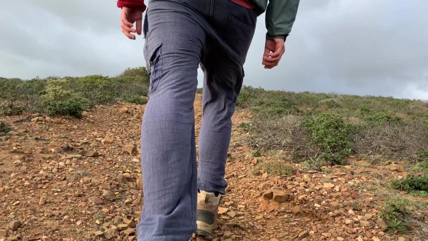 A closeup of a hikers walking feet | Shutterstock HD Video #1036596062