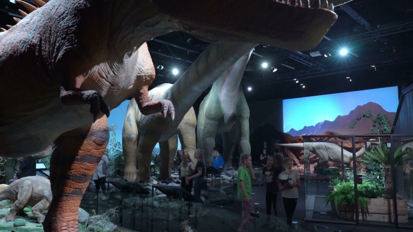 VANTAA, FINLAND - JUNE 10,2019: Children and adults see interactive models of dinosaurs. Children's educational entertainment science Museum Eureka (Heureka) | Shutterstock HD Video #1036707572