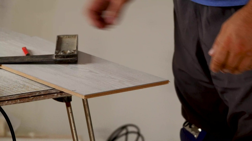 Worker mark with a pencil on a ruler a cut line | Shutterstock HD Video #1036721432