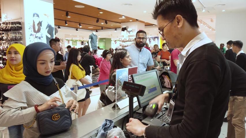 PENANG,MALAYSIA-CIRCA SEPTEMBER,2019 : People shopping at PADINI Store , a popular apparel shop in Design Village Mall as a preparation for hari raya. #1036827542