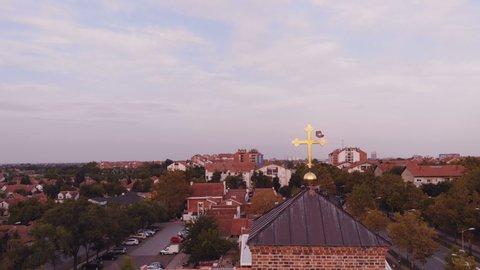 Church cross Aerial above the suburb city