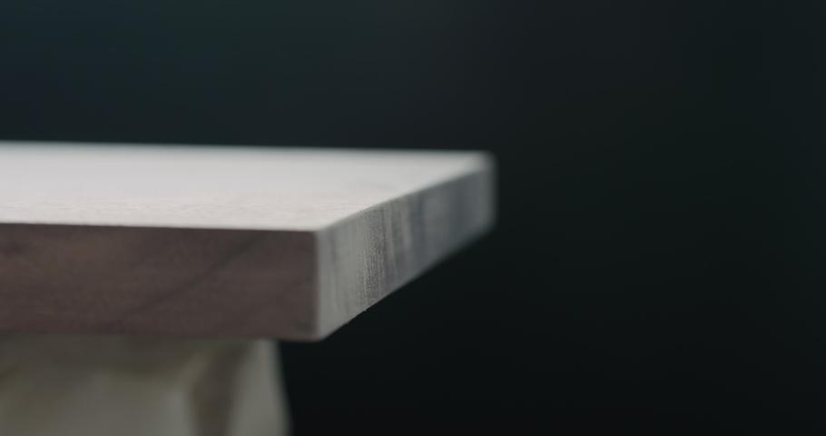 Slow motion woodworker hand sanding walnut board with sand sponge   Shutterstock HD Video #1037091992
