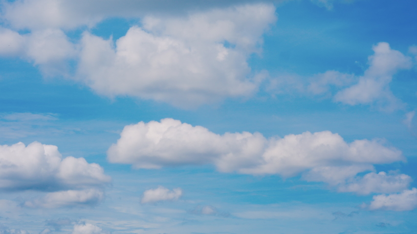 4K footage , Time lapse clouds,  Time lapse of white clouds with blue sky video loop #1037125952