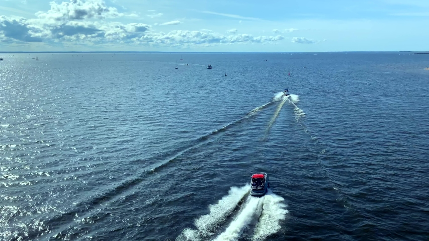 ST. PETERSBURG, RUSSIA - AUGUST 31, 2019: A pleasure boat with people sailing along the Gulf of Finland to the city. | Shutterstock HD Video #1037160722