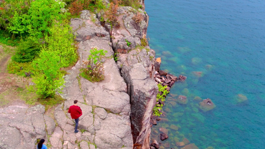 Aerial Drone, Couple at Split Rock Lighthouse State Park Minnesota | Shutterstock HD Video #1037304752