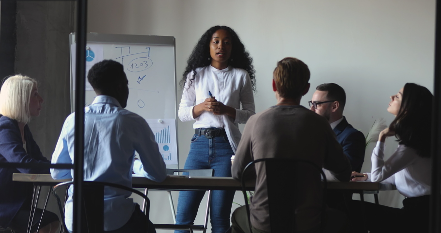 African business woman manager coach leading business meeting give flip chart presentation training consulting work group, mixed race mentor leader teach diverse people at corporate workshop concept | Shutterstock HD Video #1037333552