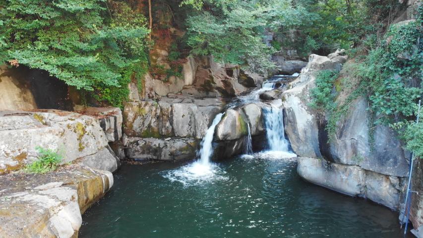Beautiful idyllic natural waterfall. Nature, beauty - Loro Ciuffenna, Tuscany, Italy | Shutterstock HD Video #1037338832